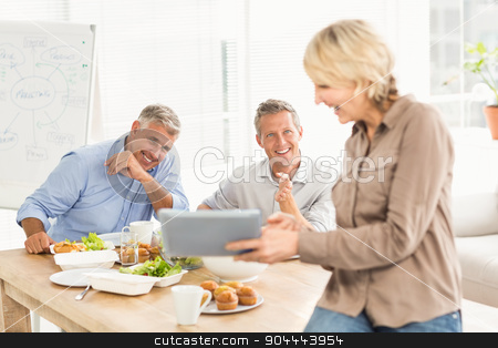 Casual business people looking at camera stock photo, Casual business people looking at camera in office by Wavebreak Media