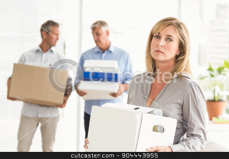 Disappointed casual businesswoman with carton stock photo, Portrait of disappointed casual businesswoman with carton in the office by Wavebreak Media