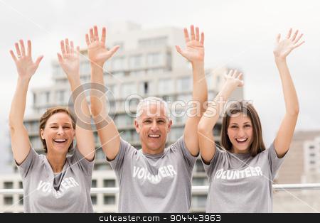 Smiling volunteers cheering stock photo, Portrait of smiling volunteers cheering on roof of building  by Wavebreak Media