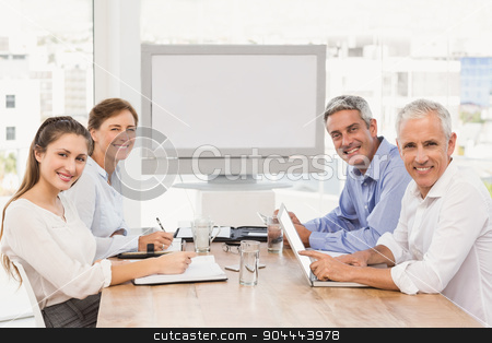 Smiling business people having a meeting stock photo, Portrait of smiling business people having a meeting in the office by Wavebreak Media