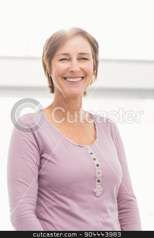 Smiling casual businesswoman  stock photo, Portrait of smiling casual businesswoman in the office by Wavebreak Media