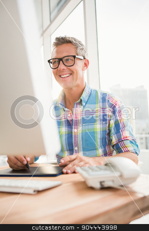 Smiling casual designer using computer and digitizer stock photo, Smiling casual designer using computer and digitizer in the office by Wavebreak Media