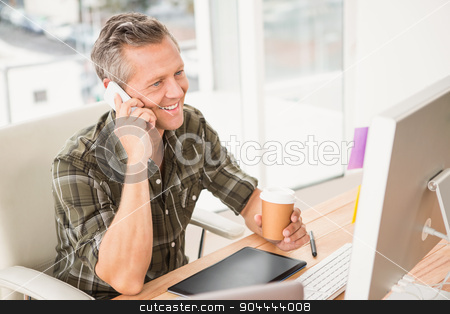 Smiling casual businessman having a phone call stock photo, Smiling casual businessman having a phone call in the office by Wavebreak Media