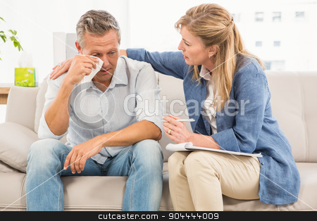 Concerned therapist comforting crying male patient stock photo, Concerned therapist comforting crying male patient in the office by Wavebreak Media