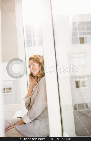 Smiling casual businesswoman having a phone call stock photo, Smiling casual businesswoman having a phone call in the office by Wavebreak Media