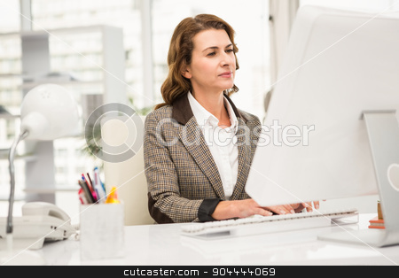 Casual businesswoman working with computer stock photo, Casual businesswoman working with computer in the office by Wavebreak Media