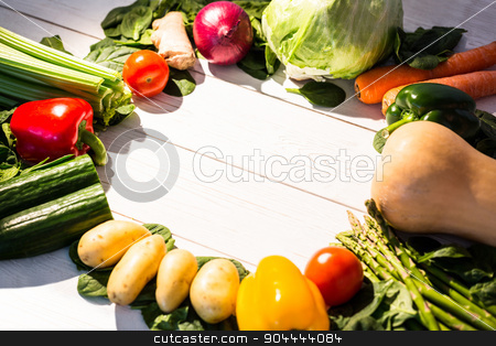 Circle of vegetables on table stock photo, Circle of vegetables on table shot in studio by Wavebreak Media