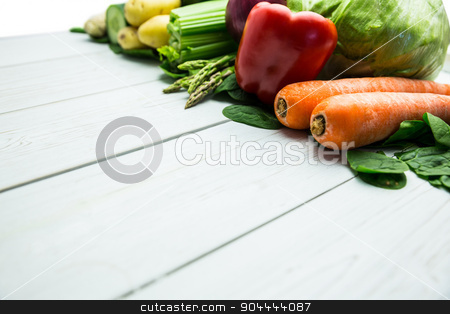 Line of vegetables on table stock photo, Line of vegetables on table shot in studio by Wavebreak Media