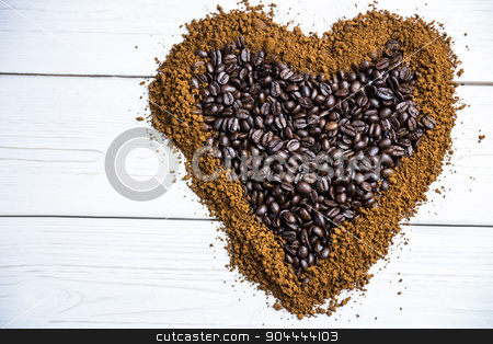 Coffee on a table in heart shape stock photo, Coffee on a table in heart shape shot in studio by Wavebreak Media