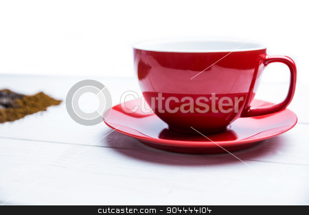 Coffee on a table with cup stock photo, Coffee on a table with cup shot in studio by Wavebreak Media