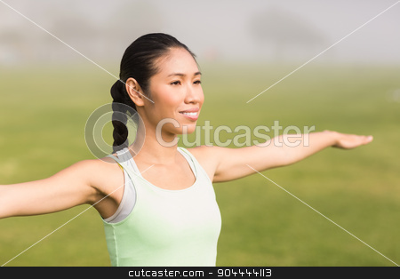 Smiling sporty woman working out stock photo, Smiling sporty woman working out in parkland by Wavebreak Media