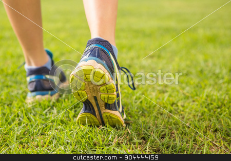 Close up view of female runners feet stock photo, Close up view of female runners feet in parkland by Wavebreak Media