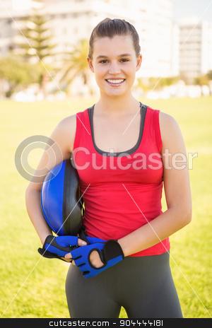 Smiling sporty blonde holding helmet stock photo, Portrait of smiling sporty blonde holding helmet at promenade by Wavebreak Media