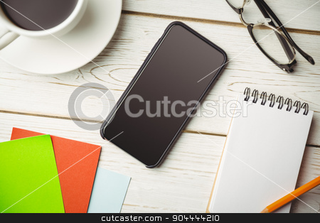 Overhead view of an desk stock photo, Overhead view of an desk with mobile phone by Wavebreak Media