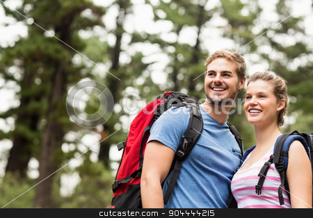 Young happy hikers looking in the distance stock photo, Young happy hikers looking in the distance in the nature by Wavebreak Media