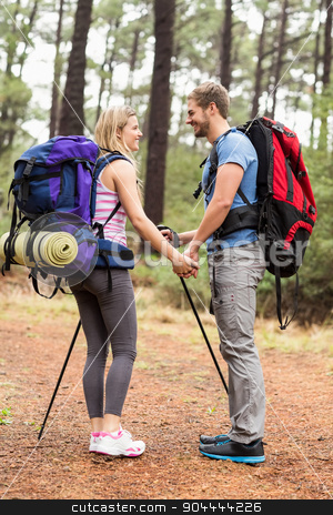 Young happy hiker couple looking at each other stock photo, Young happy hiker couple looking at each other in the nature by Wavebreak Media