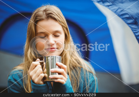 Portrait of a young pretty hiker sitting in a tent stock photo, Portrait of a young pretty hiker sitting in a tent in the nature by Wavebreak Media