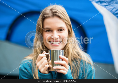 Portrait of a young pretty hiker sitting in a tent stock photo, Portrait of a young pretty hiker sitting in a tent by Wavebreak Media
