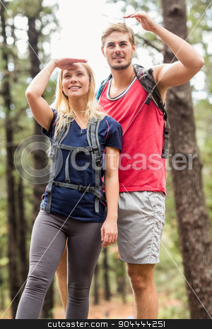 Young happy hiker couple looking away stock photo, Young happy hiker couple looking away in the nature by Wavebreak Media