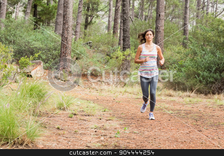 Young happy jogger walking stock photo, Young happy jogger walking in the nature by Wavebreak Media