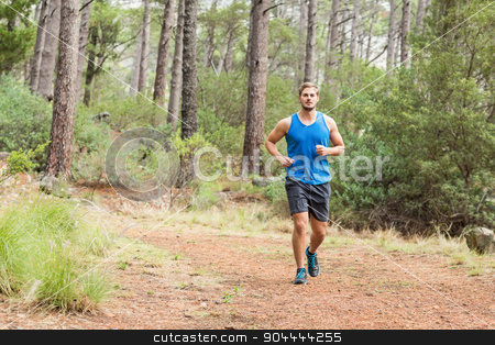 Young happy jogger running stock photo, Young happy jogger running in the nature by Wavebreak Media