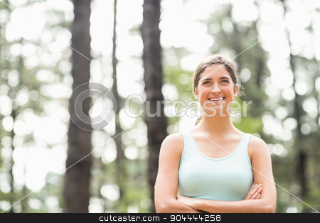 Happy jogger looking at camera stock photo, Happy jogger looking at camera in the nature by Wavebreak Media