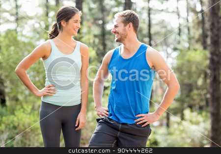 Happy joggers looking at each other stock photo, Happy joggers looking at each other in the nature by Wavebreak Media