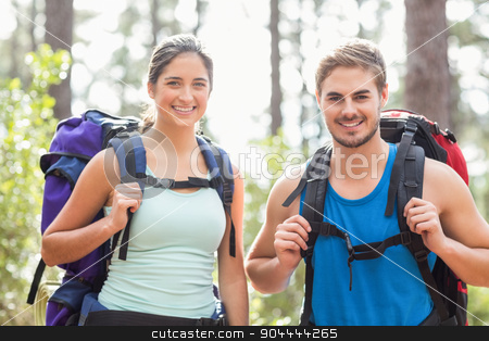 Happy joggers looking at camera stock photo, Happy joggers looking at camera in the nature by Wavebreak Media