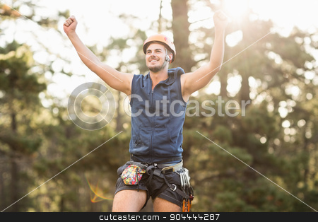 Handsome young hiker looking away and cheering stock photo, Handsome young hiker looking away and cheering in the nature by Wavebreak Media