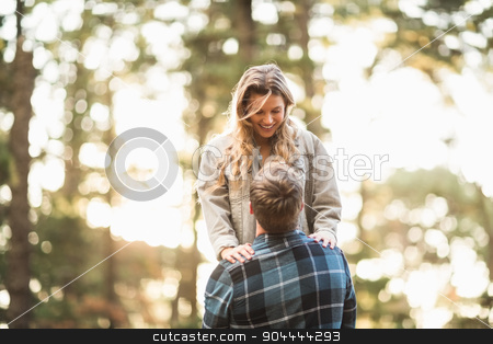 Man holding his smiling girlfriend  stock photo, Man holding his smiling girlfriend in the nature by Wavebreak Media