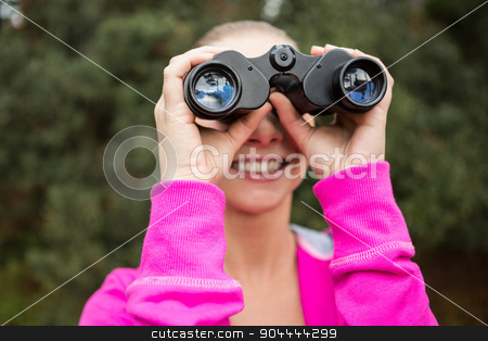 Female hiker looking through the binoculars stock photo, Close up view of a female hiker looking through the binoculars by Wavebreak Media