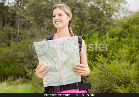 Smiling blonde hiker with map stock photo, Smiling blonde hiker with map in the nature by Wavebreak Media