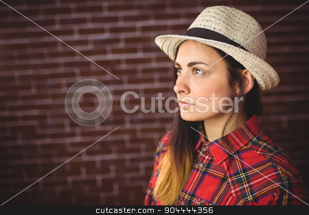 Beautiful hipster in check shirt stock photo, Beautiful hipster in check shirt on red brick background by Wavebreak Media