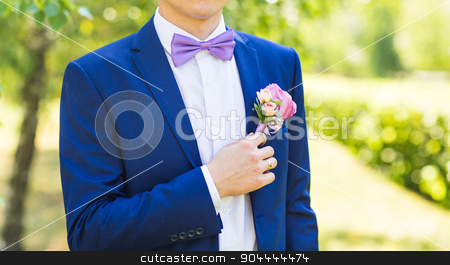 wedding boutonniere on suit of groom stock photo, colorful wedding boutonniere on suit of groom by Satura86