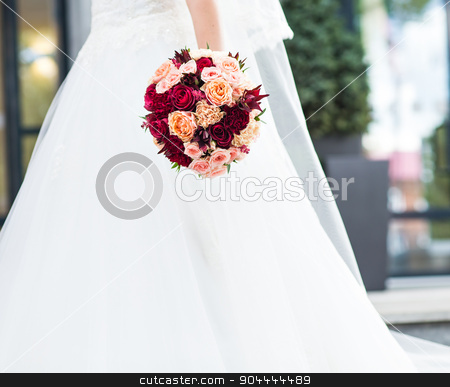 wedding bouquet in hands of the bride stock photo, Beautiful wedding bouquet in hands of the bride by Satura86