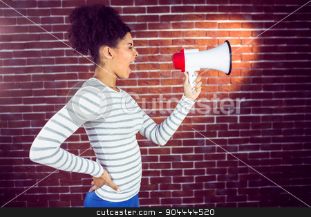 Pretty woman shouting with megaphone stock photo, Pretty woman shouting with megaphone on a brick wall by Wavebreak Media
