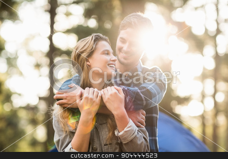 Happy young camper couple looking at each other stock photo, Happy young camper couple looking at each other in the nature by Wavebreak Media