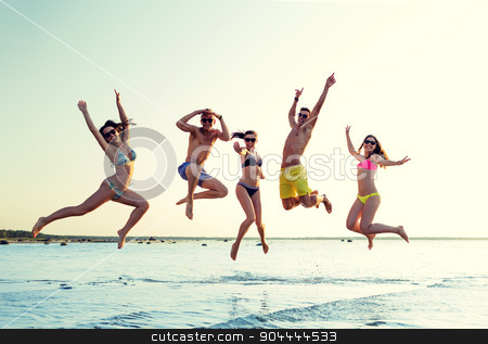 smiling friends in sunglasses on summer beach stock photo, friendship, sea, summer vacation, holidays and people concept - group of smiling friends wearing swimwear and sunglasses jumping on beach by Syda Productions