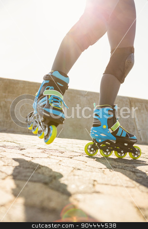 Close up view of inline skates skating stock photo, Close up view of inline skates skating at promenade by Wavebreak Media