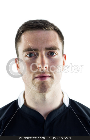 A rugby player looking at the camera stock photo, Portrait of a frowning rugby player on a white background by Wavebreak Media