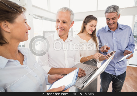 Business people using several electronic devices stock photo, Business people using several electronic devices in the office by Wavebreak Media
