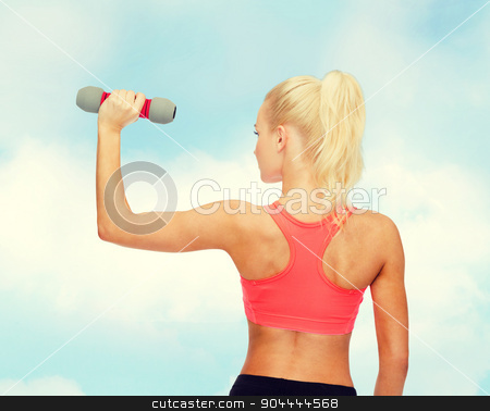 young sporty woman with light dumbbell stock photo, fitness, sport and diet concept - young sporty woman with light dumbbell by Syda Productions