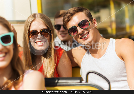 group of smiling friends traveling by tour bus stock photo, friendship, travel, vacation, summer and people concept - group of smiling teenage friends and couple in sunglasses traveling by tour bus by Syda Productions