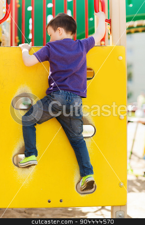 happy little boy climbing on children playground stock photo, summer, childhood, leisure and people concept - happy little boy on children playground climbing frame from back by Syda Productions