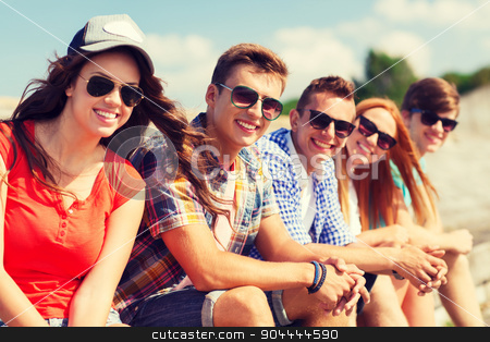 close up of smiling friends sitting on city street stock photo, friendship, leisure, summer and people concept - close up of smiling friends sitting on city street by Syda Productions
