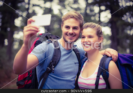 Young happy hikers taking a selfie stock photo, Young happy hikers taking a selfie in the nature by Wavebreak Media