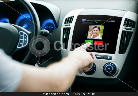 male hand receiving video call on car panel screen stock photo, transport, modern technology, communication and people concept - male hand pushing button and receiving video call from woman on car panel screen by Syda Productions