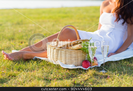 close up of woman with food basket and champagne stock photo, people, summer and holidays concept - close up of woman with food basket and champagne glasses on picnic by Syda Productions