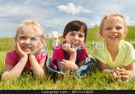 group of kids lying on blanket or cover outdoors stock photo, summer, childhood, leisure and people concept - group of happy kids lying on blanket or cover outdoors by Syda Productions