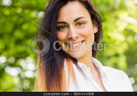 Beautiful brunette in the park stock photo, Beautiful brunette in the park on a sunny day by Wavebreak Media